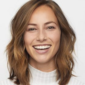 smiling woman with brown hair - haircuts